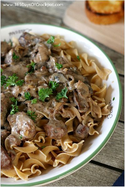 Recipe for French Onion Beef Stroganoff. Caramelized onions, tender beef chunks and mushrooms served over egg noodles. All made in the slow cooker!
