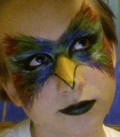This picture is more straight forward about depicting a beak than I would be but it still is visually pleasing and sends a clear message of what kind of animal this person is. I also like how it blends in with the eye makeup nicely.