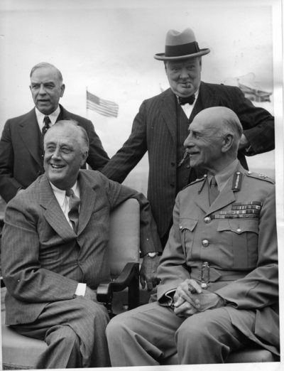 Winston Churchill, looking especially puckish, and Canadian PM William Lyon Mackenzie King stand behind U.S. President Franklin Roosevelt and Canada's Governor-General, the Earl of Athlone, at a photo opp during the first Quebec Conference on Aug. 18, 1943. Among other things, the leaders agreed in principle to launch the invasion of France the following May (D-Day finally came on June 6, 1944).