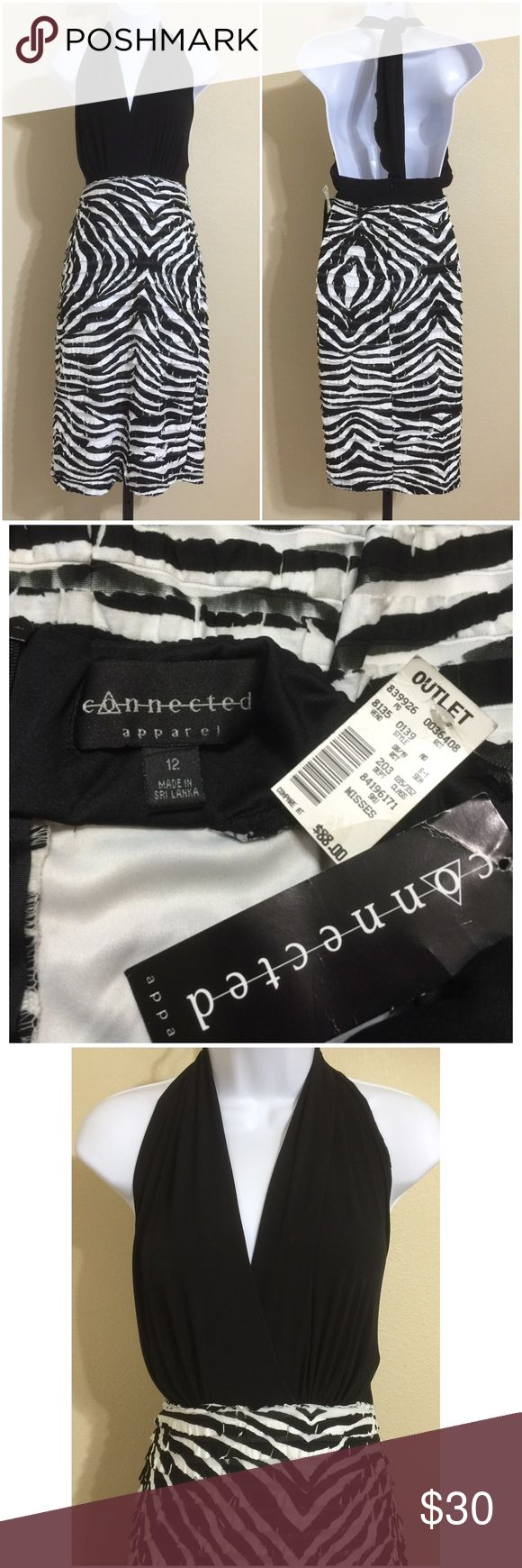 Connected Apparel Dress Size 12 Connected Apparel Women's Stretch, Body-Con Dress Size 12 Black & White Colors Tiered Ruffled Halter Strap Lightly Padded Bust Lined Skirt Portion Rear Zip Semi-Striped Skirt Portion Hand Wash Self 97% Polyester 3% Spandex Contrast 96% Polyester 4% Spandex Lining 100% Polyester Bust Approx. 36 Inches Waist Approx. 30 Inches Hips Approx. 38 Inches Length Approx. 38 Inches Sweep Approx. 40 Inches Compare Measurements To Your Own Well Fitting Garment To Ensure A…