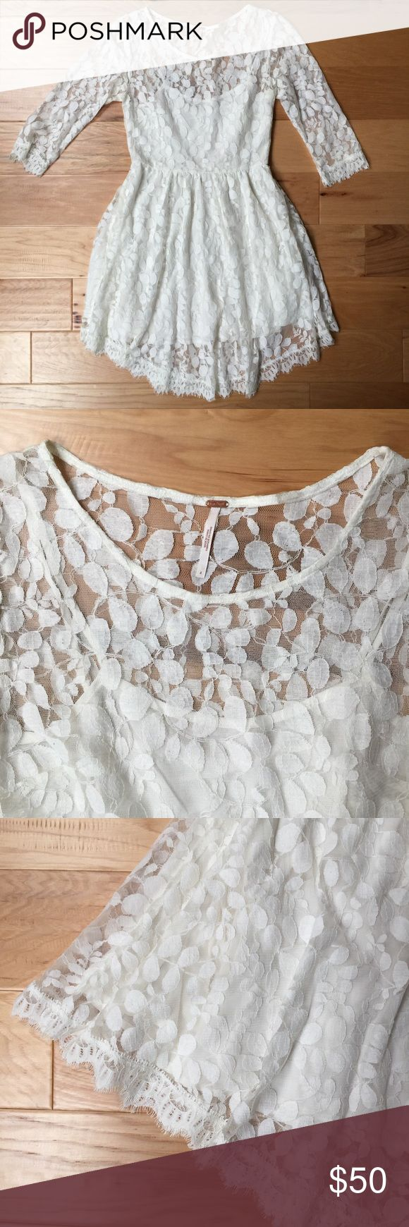 free people | white lace dress In great used condition beautiful white dress with organic lace pattern. Inner lining with sheer outer lace, three quarter sleeves, and very flowy skirt. Absolutely gorgeous. No longer fits me. Just machine washed it once. Purchased from Bloomingdales. Clean, Comes from pet and smoke free home. Free People Dresses