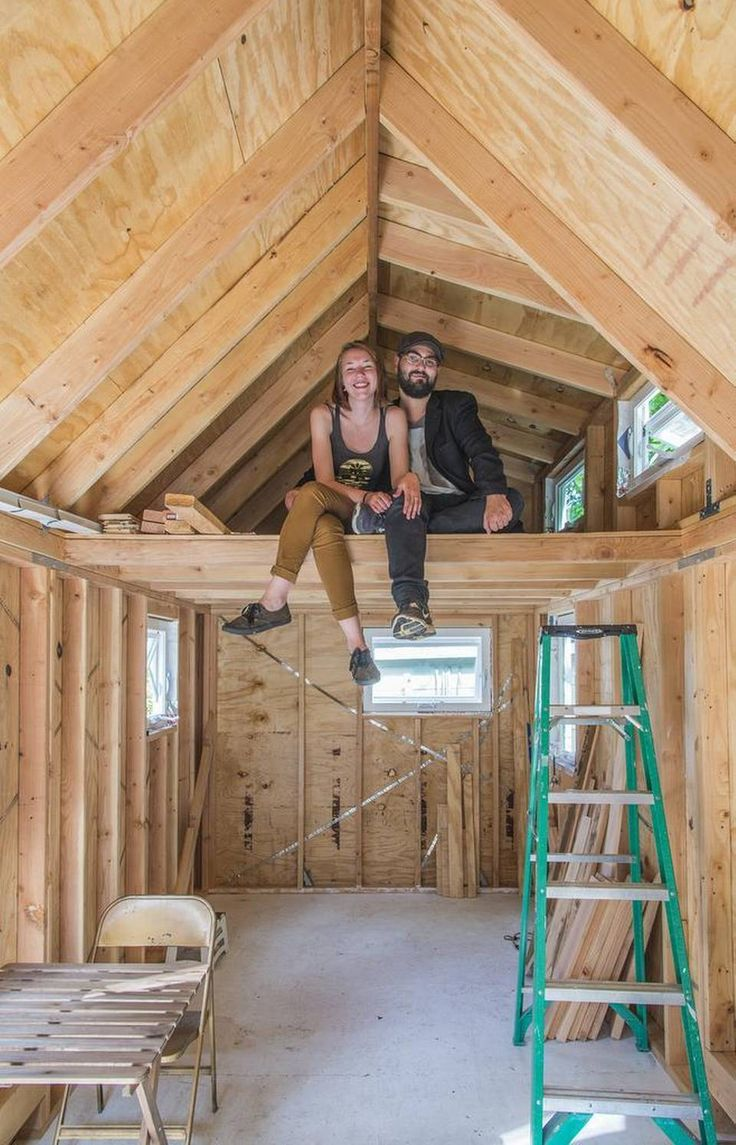 Kansas City couple Jeremy Luther and Kendall Quack pose in their tiny house.