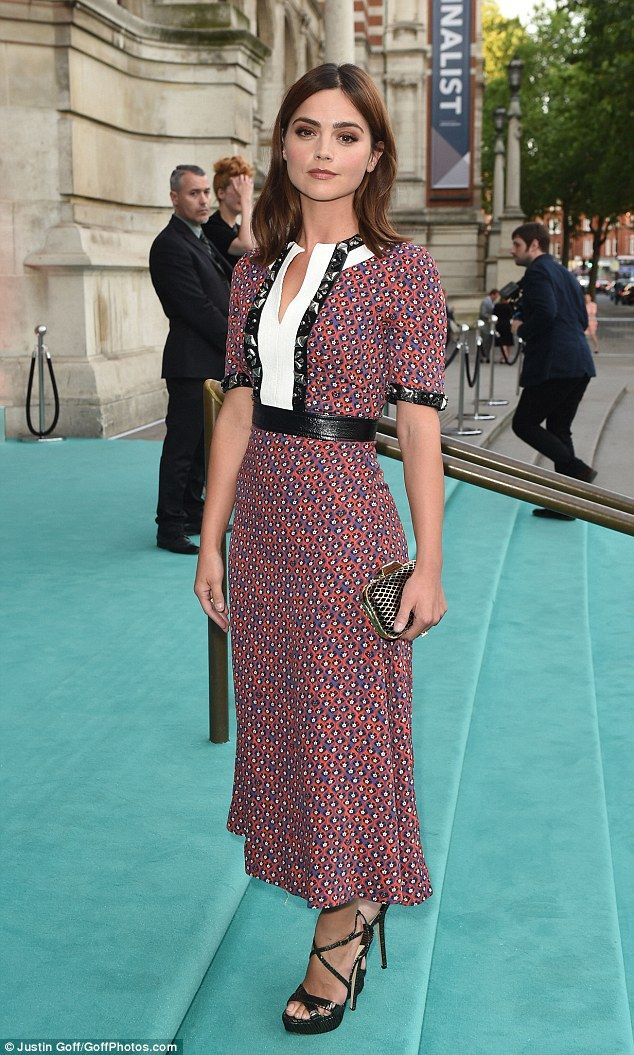Ladylike: Jenna's dress stopped well below her finely polished knees and featured a round neckline with deep V-opening, giving the slightest hint of décolletage