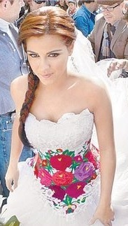 A Mexican traditional embroidered wedding dress, worn by Maite Perroni