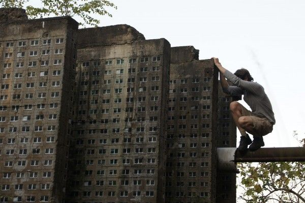 Street Artist EVOL Creates Towering Residential Skyscrapers out of Concrete Slabs urban decay urban street art stencils sculpture