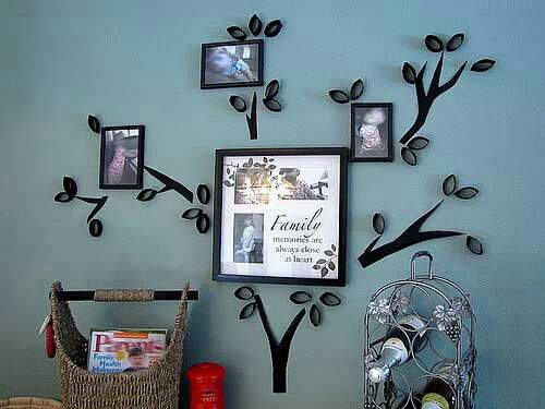 Family tree wall decor. Paint branches, paint & cut cardboard tubes, get family pictures, frame them and hang them in open spots on the wall. Voilà!
