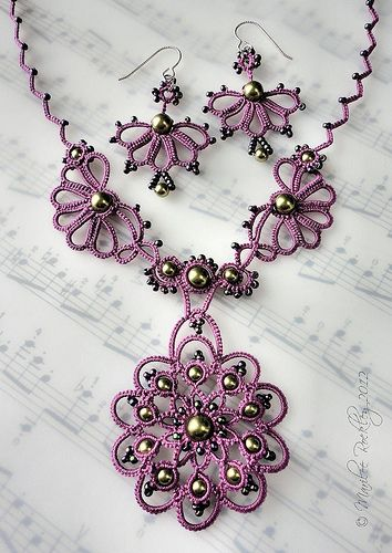 """The earrings are my """"Carnival"""" pattern, and the necklace a design that I made up as I went, using the technique of shuttle tatting. In Lizbeth thread size 20 """"Country Grape"""" with light green crystal pearls and seed beads."""