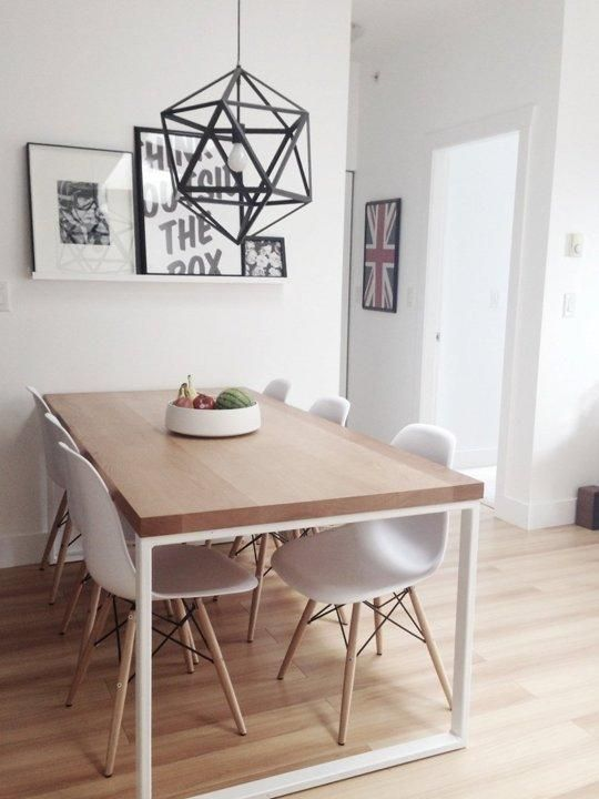 I love this table and those chairs. You can make the most out of a small dining area by keeping it simple, then punctuating with a few pieces like art and a interesting light fixture.