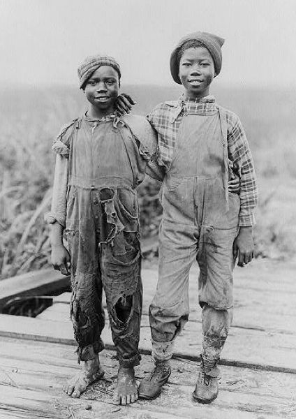 African-American boys whose stories have been left untold except for this touching photograph.