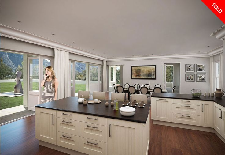 Kitchen design in Kerry House, Adare Place. As in most Urban Space home designs, there is an open plan dining-kitchen area. This allows for the energy in the room to flow freely. Large doors open out from the kitchen to the garden, the perfect design for entertaining guests.