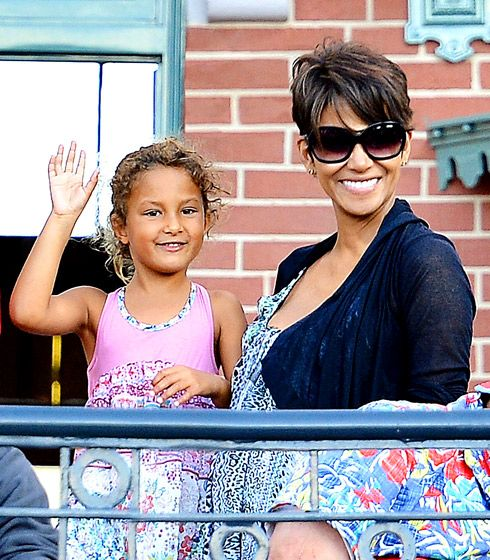 Pregnant at Disney! Pregnant Halle Berry and daughter Nahla waved at the Soundsational Parade at Disneyland in Anaheim, Calif. July 22.