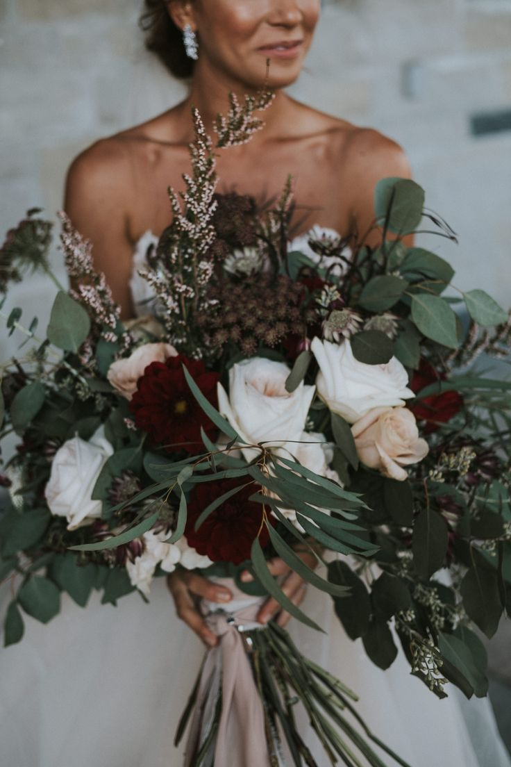 organic red, green and white bridal bouquet; PHOTOGRAPHY Joel + Justyna Bedford; destination wedding photographers