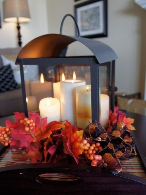 homemade halloween decorations and thanksgiving centerpiece ideas. candle lantern w/ fall leaves, berries, ribbon