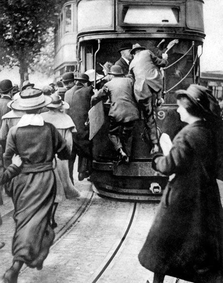 Londoners rush to get on a bus in 1919