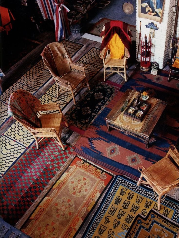 My grandmothers home...Mutli rugs! - World of Interiors Love this. I need to pull up alll the carpeting, lay tile then cover it with rugs like these.