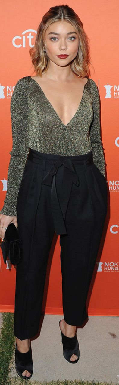 Who made Sarah Hyland's black pants, gold top, clutch handbag, and shoes?