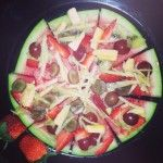 Fruit pizza.. yummy and healthy. Watermelon base, grapes, strawberries, kiwi fruit, sliced banana and grated apple. Delicious fruit salad..