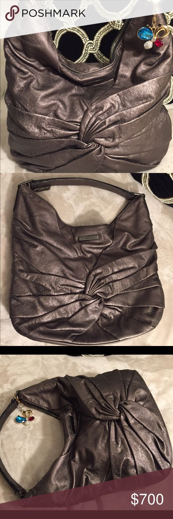 Burberry metallic Maggie knot bag New Burberry Lamb skin Maggie knot hobo bag! Sexy metallic color bag with gunmetal hardwear. This bag is simple yet very stylish. 😍 it's an everyday use bag!! Has classic check nova Burberry interior with a very modern look on exterior. 🌟ONLY SELLING🌟 Burberry Bags Hobos