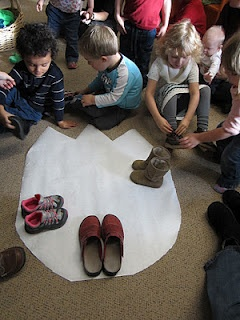 Make Life-Size Cut-Outs of Dinosaur Footprints and Have Kids See How Many of Their Feet it Takes to Fill Them!