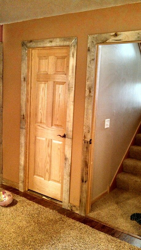 Pallet door trim project pinterest sliding barn for Wood trim around doors