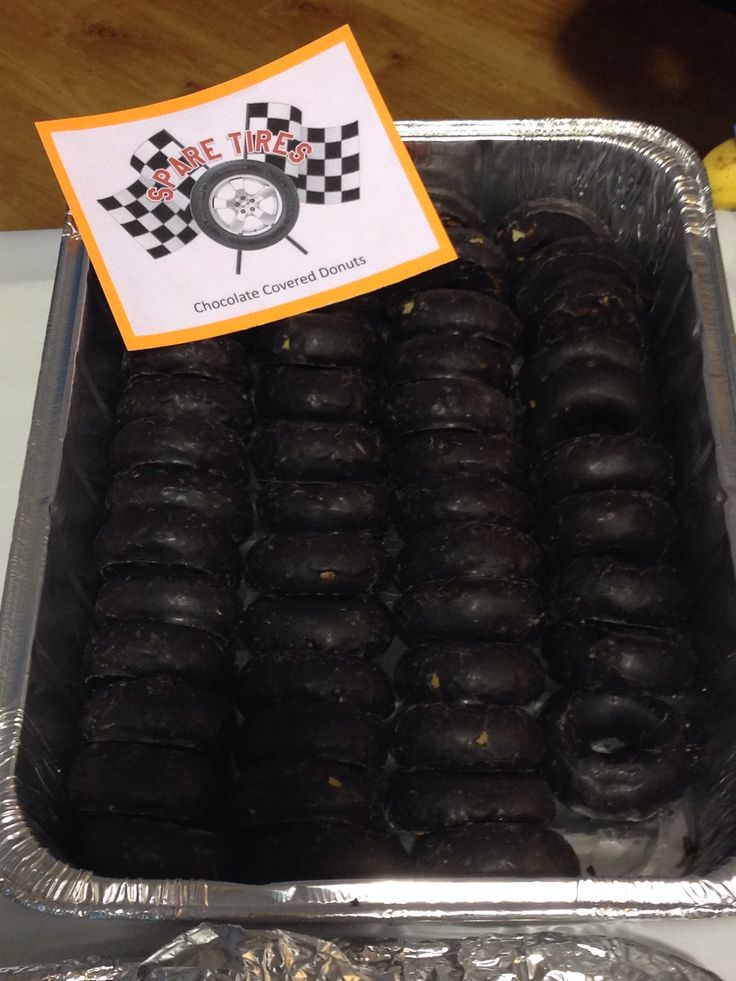 Spare tires. Scouts Pinewood derby snacks. Chocolate covered donuts.