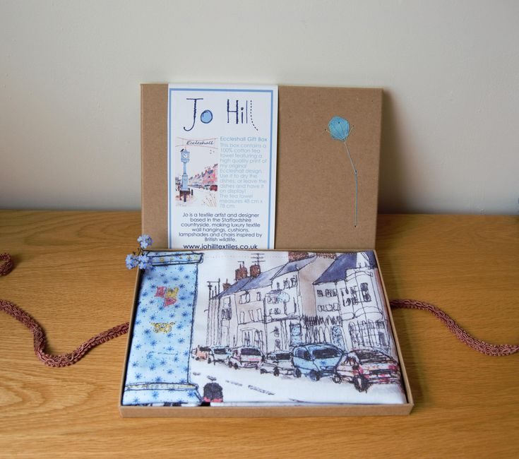 This luxury gift box contains a print of my Eccleshall design on a high quality, 100% cotton tea towel; the perfect gift for those who love this quaint Staffordshire town!The tea towel is carefully folded and comes supplied in a lovely kraft presentation box. I have added hand-stitched decoration to the front of the box - this is the box that you can gift again and again!