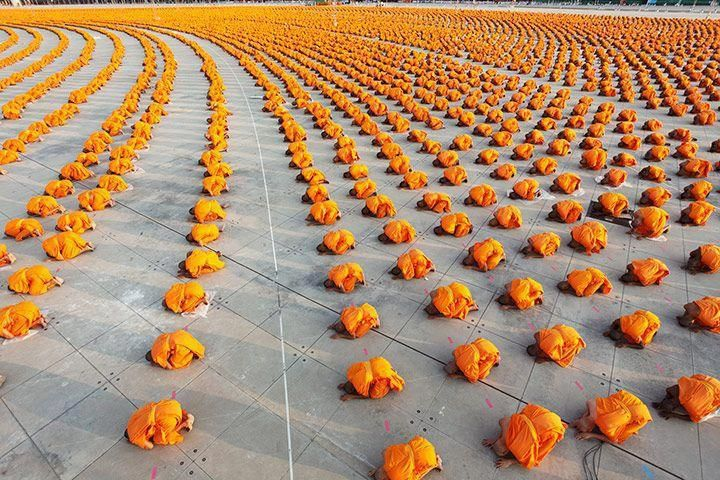 34,000 monks at Wat Phra Dhammakaya, a Buddhist temple in Thailand.  ed: I forget if I ever posted this, but it's an impressive photograph.