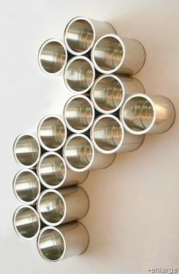 these cans are used as art but I think it would make really fun craft room storage