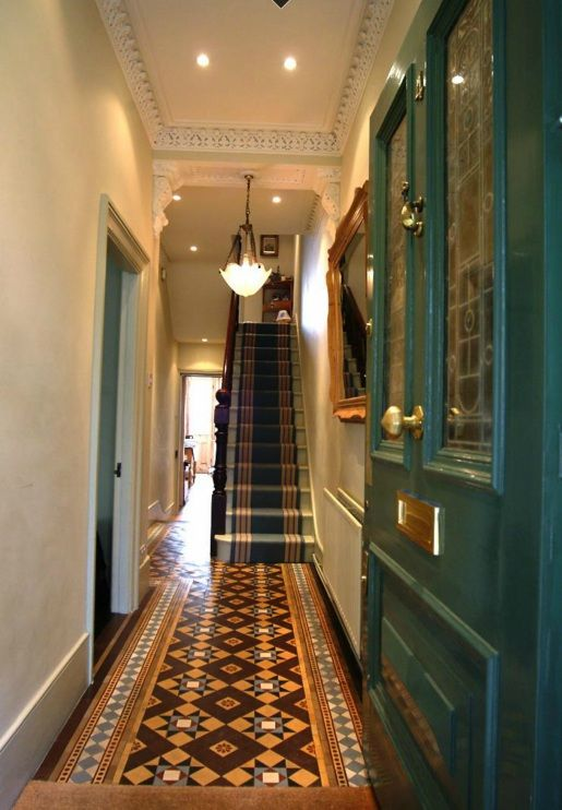 "Almost, but not quite? I like the colours of the door, floor and runner. I am less enthusiastic about the spot down-lights, the period light pendant and ""floating"" mirror, and the stair-runner stripes fighting with the tiling..."