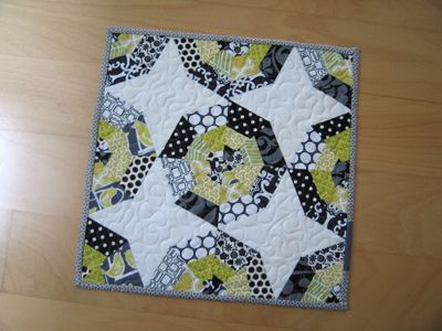 Spider web quilt--it seems like a string quilt with a bit more structure.