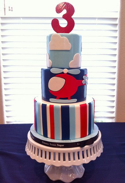 Red, White, Light Blue and Dark Blue Striped Helicopter in Clouds Cake