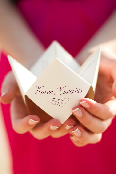 Wedding programs origami folded into chinese fortune tellers. These would be a pain to fold, but so cool!