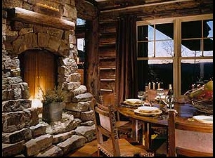 OMG I am in love with this fireplace in this log home.  Clearly, this is the second owner, because the dining room chairs are ugly and surely do not match up to the charm of the fireplace!  :)