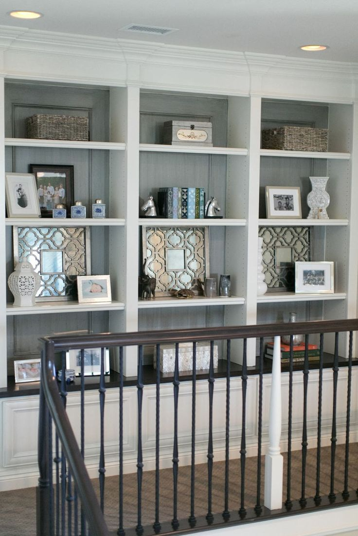 Bookcase with gray back. Love the banister too!