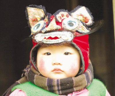 Chinese tiger hat on the most precious baby ever. ♥