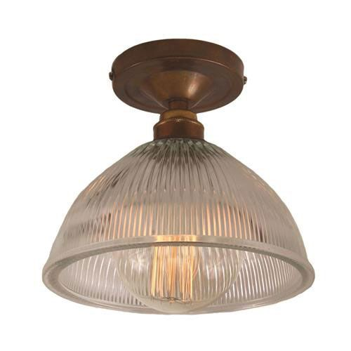 Designed and manufactured in Ireland this Erbil Prismatic Flush Ceiling Fitting diffuses light to give a warm glow.
