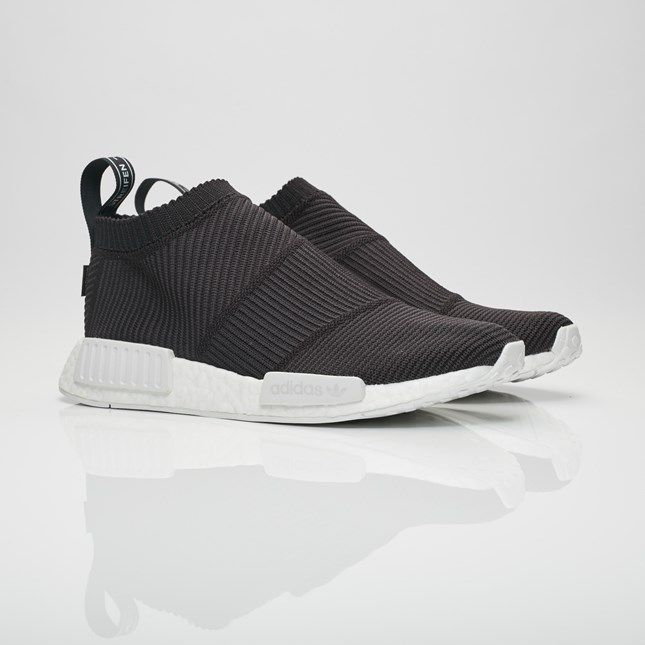 These shoes are built with a modern sock-like construction and bold  archival details to form a dynamic new concept. Made with a flexible adidas  Primeknit ...