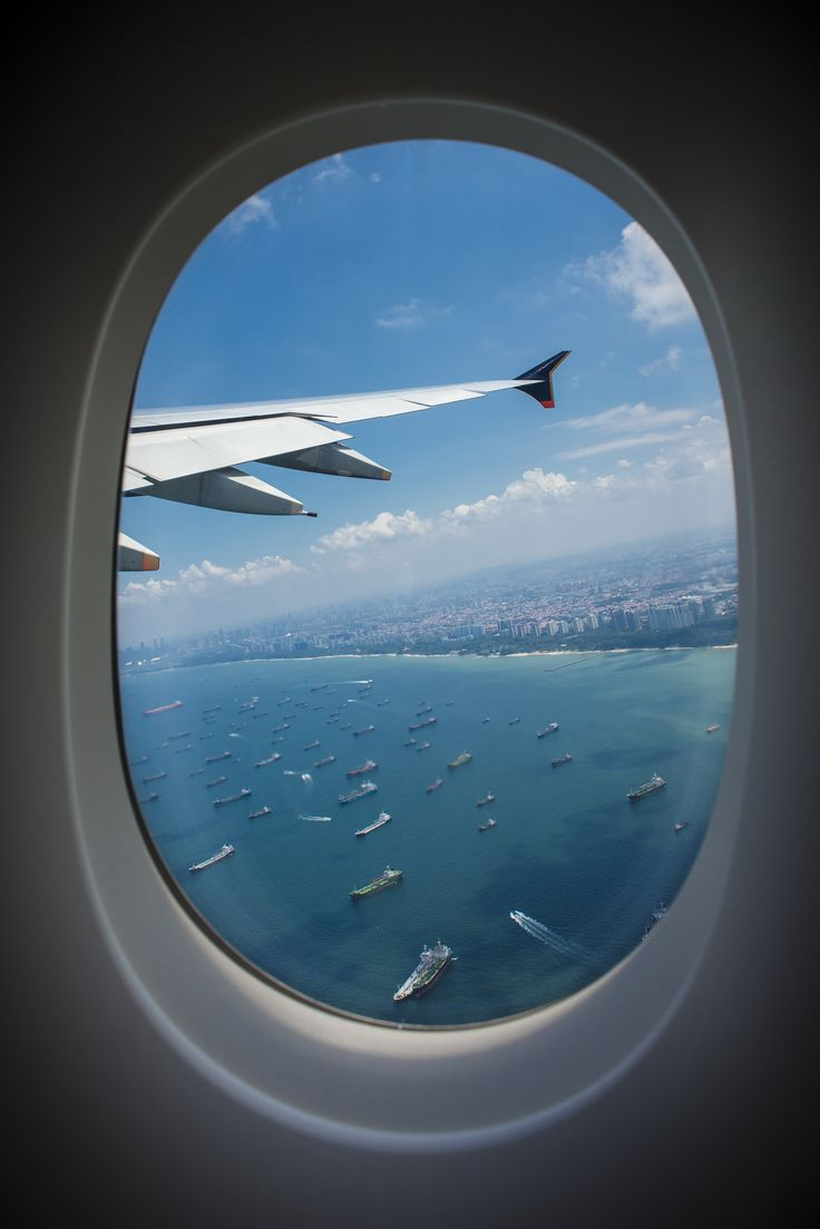 in-flight-view-through-an-airplane-window-over-singapore ...