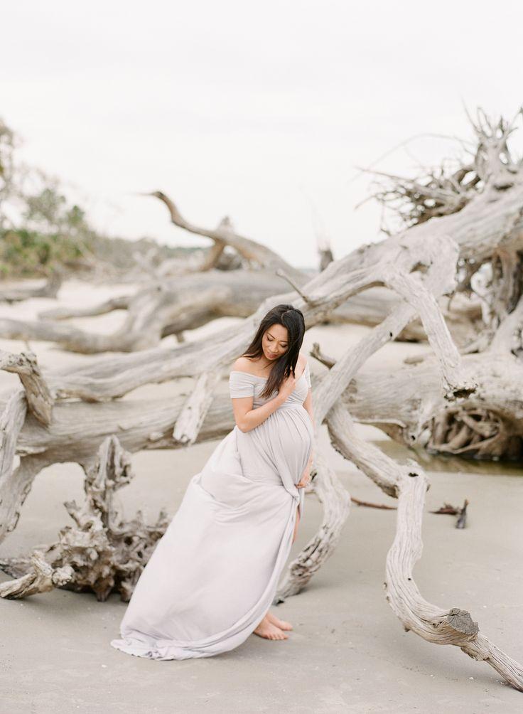 Fine Art Maternity Session | Driftwood Beach | Christine + David | Grey Dress | The Happy Bloom Fine Art Photography | www.thehappybloom.com | Baby Belly | Maternity Posing