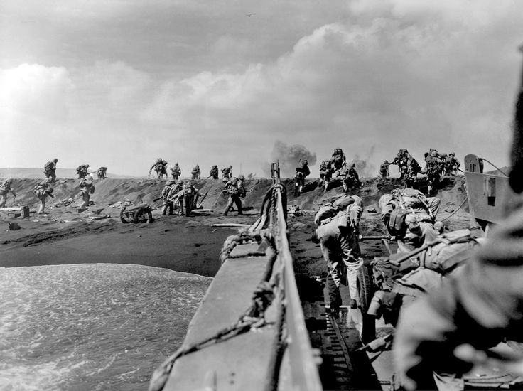 U.S. Marines hit the beach and charge over a dune on Iwo Jima in the Volcano Islands Feb. 19, 1945, the start of one of the deadliest battles of the war against Japan.