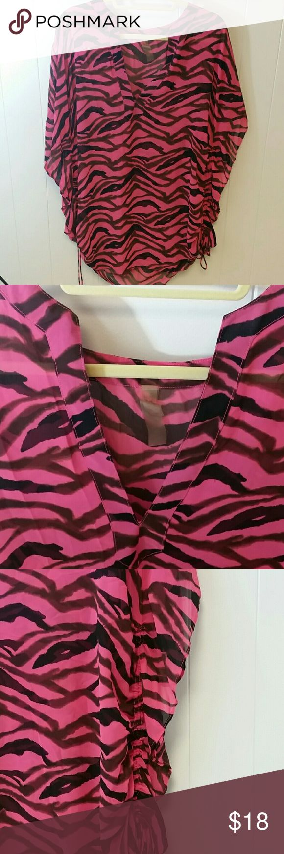 Victoria Secret bathing suit cover up. Extremely flattering zebra print cover up with side ties to pull it up on each of the sides. Size on tag says m/L Victoria's Secret Swim Coverups