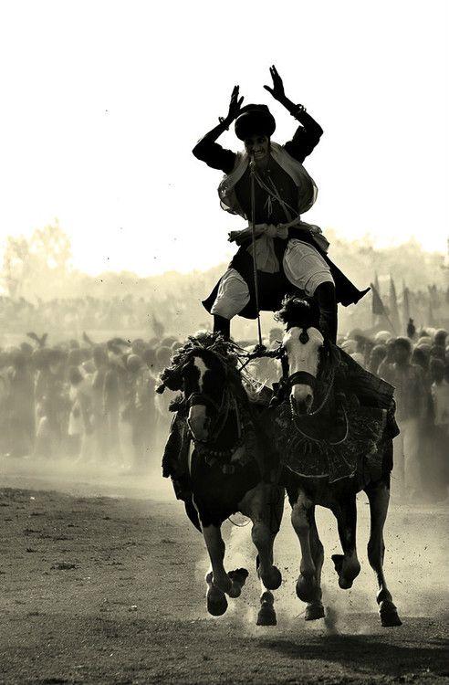 Wonderful exhibition of horsemanship at rural games in Punjab, India.