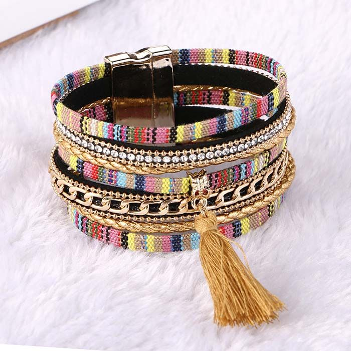 Ashanti Multilayer Tassle Bangle Bracelet  Cuff - Gold  www.evcostudio.online  Gorgeous tapestry wrap bangle bracelets have so many facets to them from, rhinestones, gold chain, chord, tassles and more all stylishly finished off with a magnetised buckle.