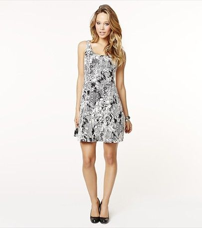 This snake jacquard flare dress is perfect for a night out! Finish up the look with one of our statement necklaces.