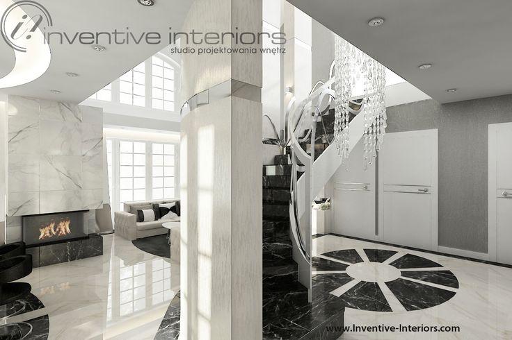 Projekt holu Inventive Interiors - luksusowy hol ze schodami po łuku - długi żyrandol