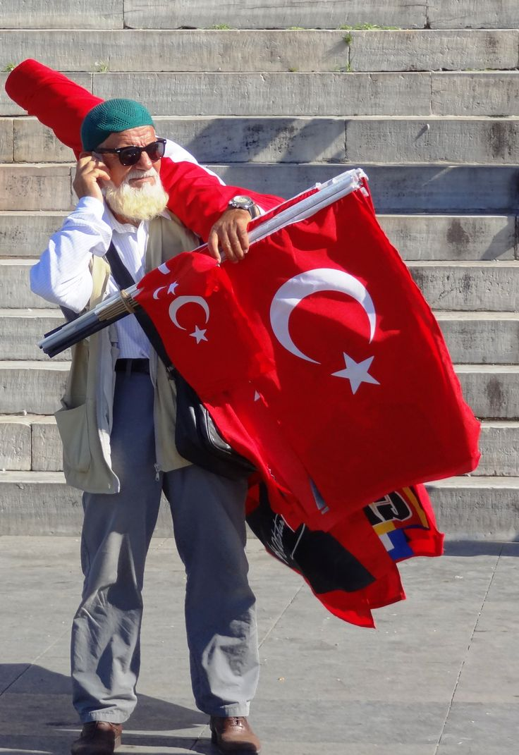 Flag seller, Istanbul, Turkey. The flag of Turkey is often called al bayrak (the red flag), and is referred to as al sancak (the red banner) in the Turkish national anthem.