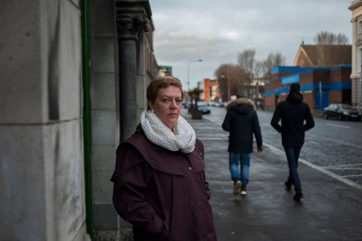 IRELAND, Dublin - A Blot on Ireland's Past, Facing Demolition - January 15, 2018.  Image:  Samantha Long outside the Gloucester Street laundry this month. Ms. Long's birth mother, Margaret Bullen, was born in a mental institution and transferred to the Gloucester Street laundry at age 16.
