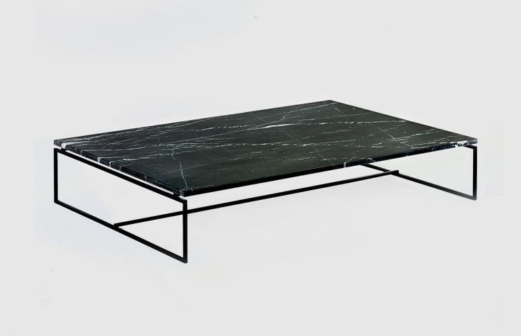 Dialect serien är resultatet av en strävan efter harmoni mellan trä, stål och marmor. En hel del tid och ansträngning har investerats i att hitta rätt balans mellan de olika egenskaperna hos varje enskild material. Former och texturer är lika balanserad, medan subtilitet är nyckeln. Designen tjänar mer än ett syfte: Borden kan användas som ett nattduksbord eller som ett sidobord. De abstrakta linjerna bidrar till idén om att skapa ett föremål som inte medför sig på sin omgivning. D I A L E C…