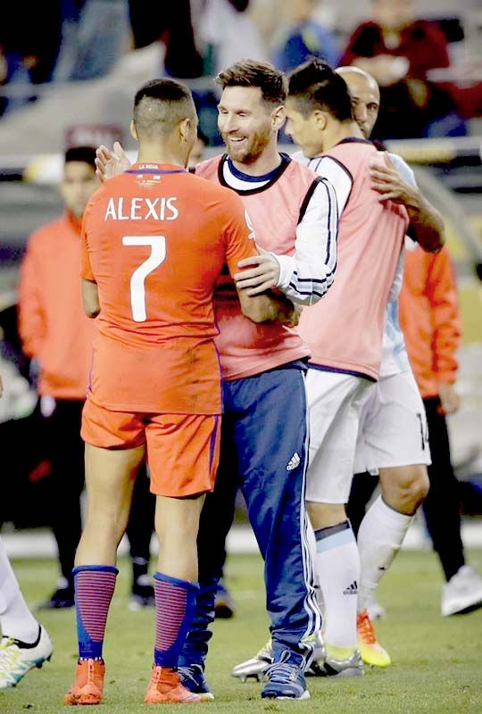 Lionel Messi and Alexis Sanchez after the group stage game between Argentina and Chile on June 6, 2016 in Santa Clara, California