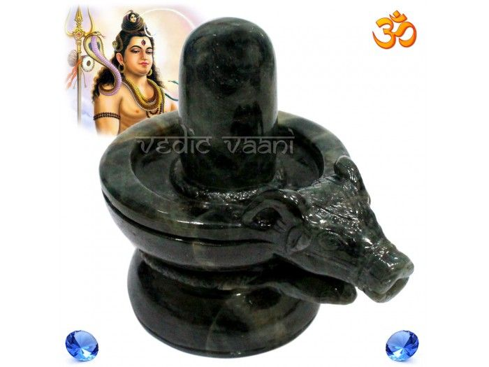 Nandi Shivling With Snake in Blue Sapphire Gemstone buy online from India. http://vedicvaani.com/Nandi-Shivling-Snake-Blue-Sapphire .This shivaling includes lord shiva,nandi,snake, blue sapphire or neelam. A beautiful Nandi Shivlingam with Snake carved out of natural blue sapphire stone.Natural black colour lingam from India at Vedic Vaani.